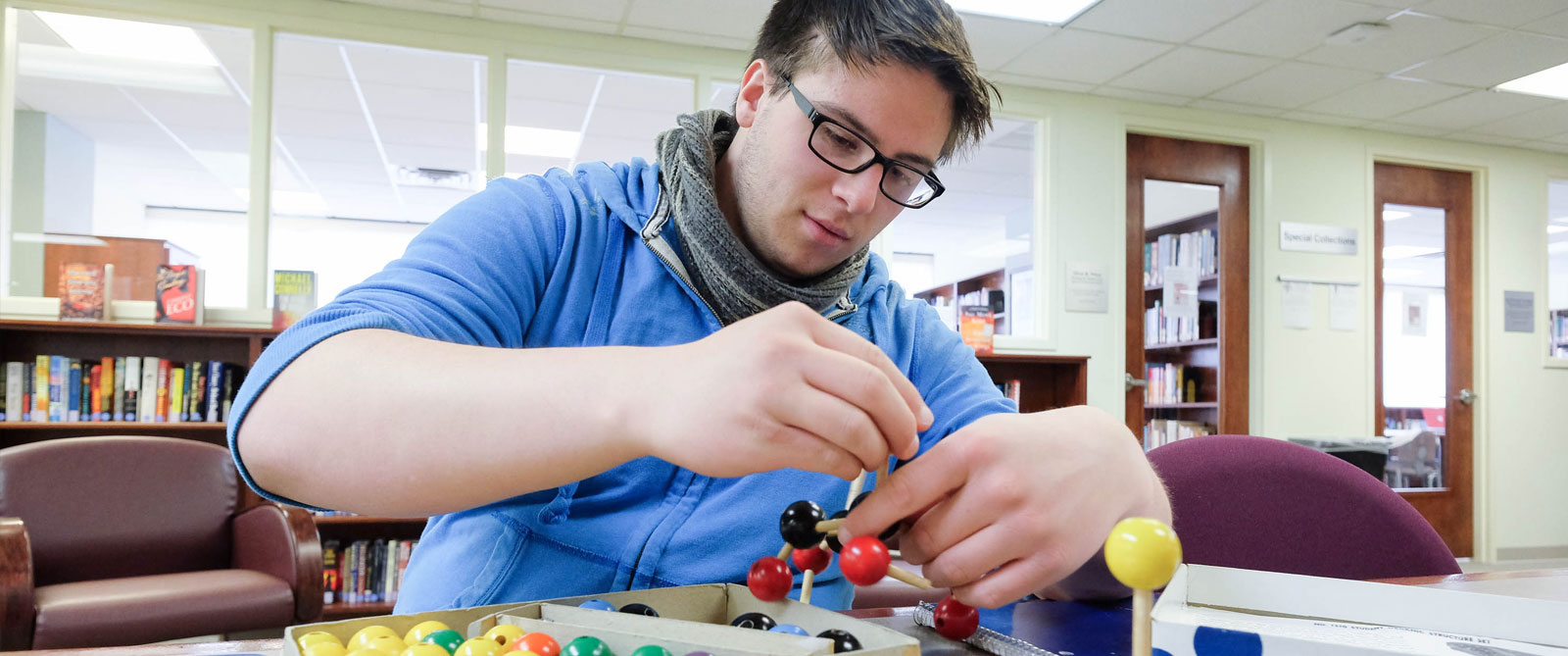 Student building a model of a chemical