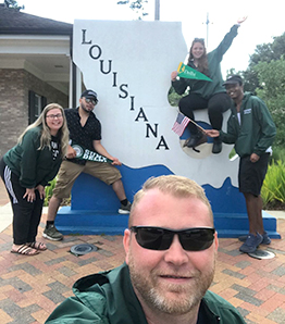 Sean Perhsson in front of Louisianna State sign