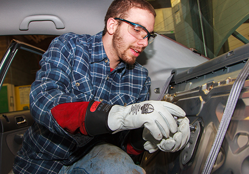 Student working on the interior of a car