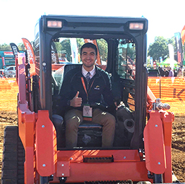 Student test driving a skid steer