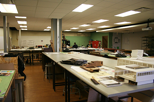 Students working in a model building lab
