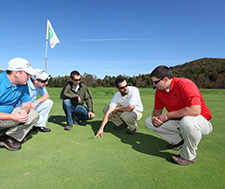 Students study golf course operations