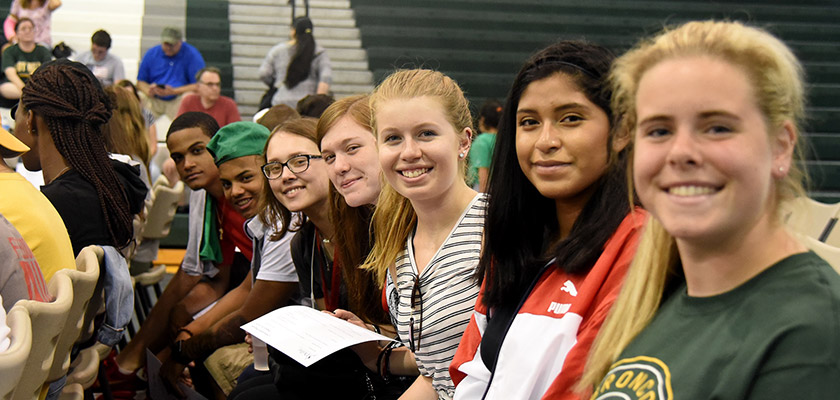 Students attending an orientation event in the field house