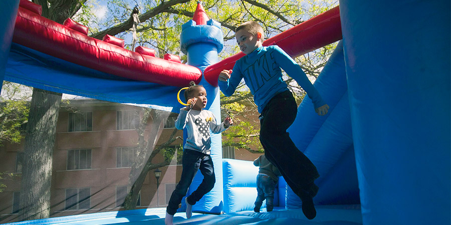 Kids in bounce house at Family Weekend