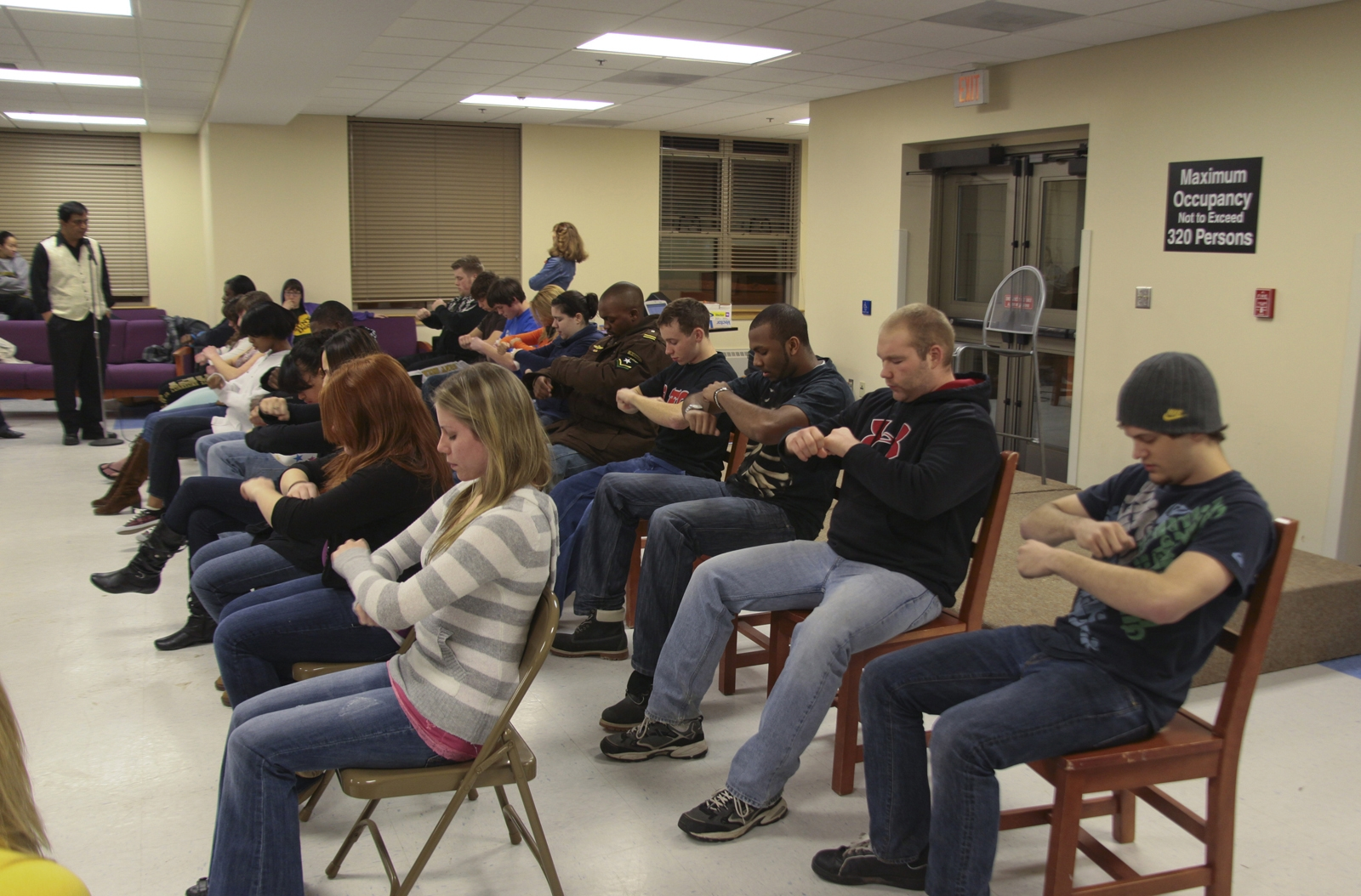 Doc provides instruction to hypnosis participants