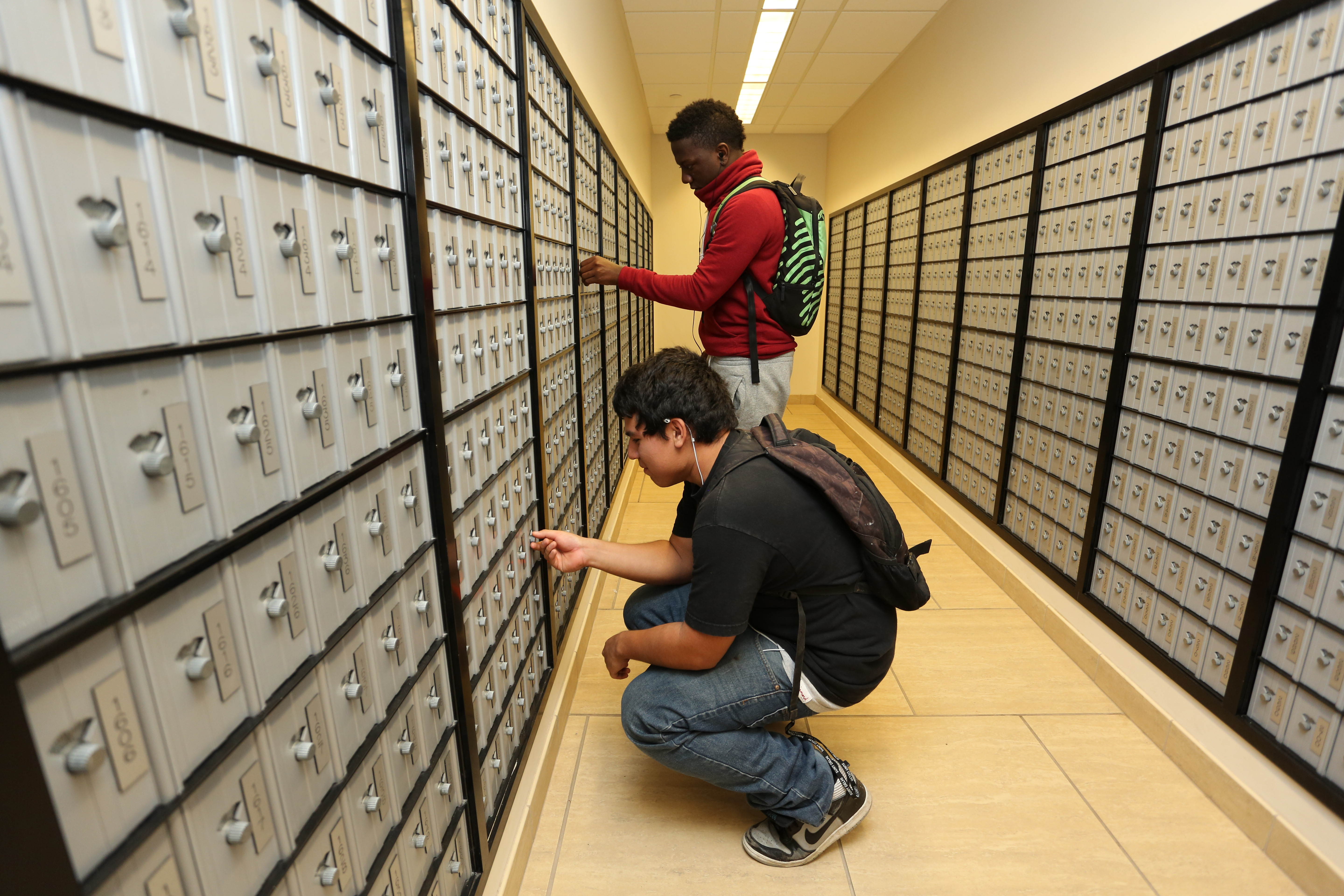 Students checking their mailboxes