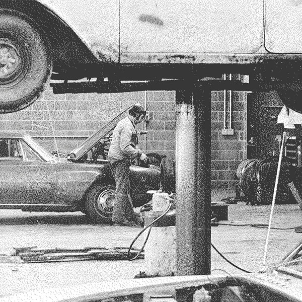 Vintage image of man working on automobile