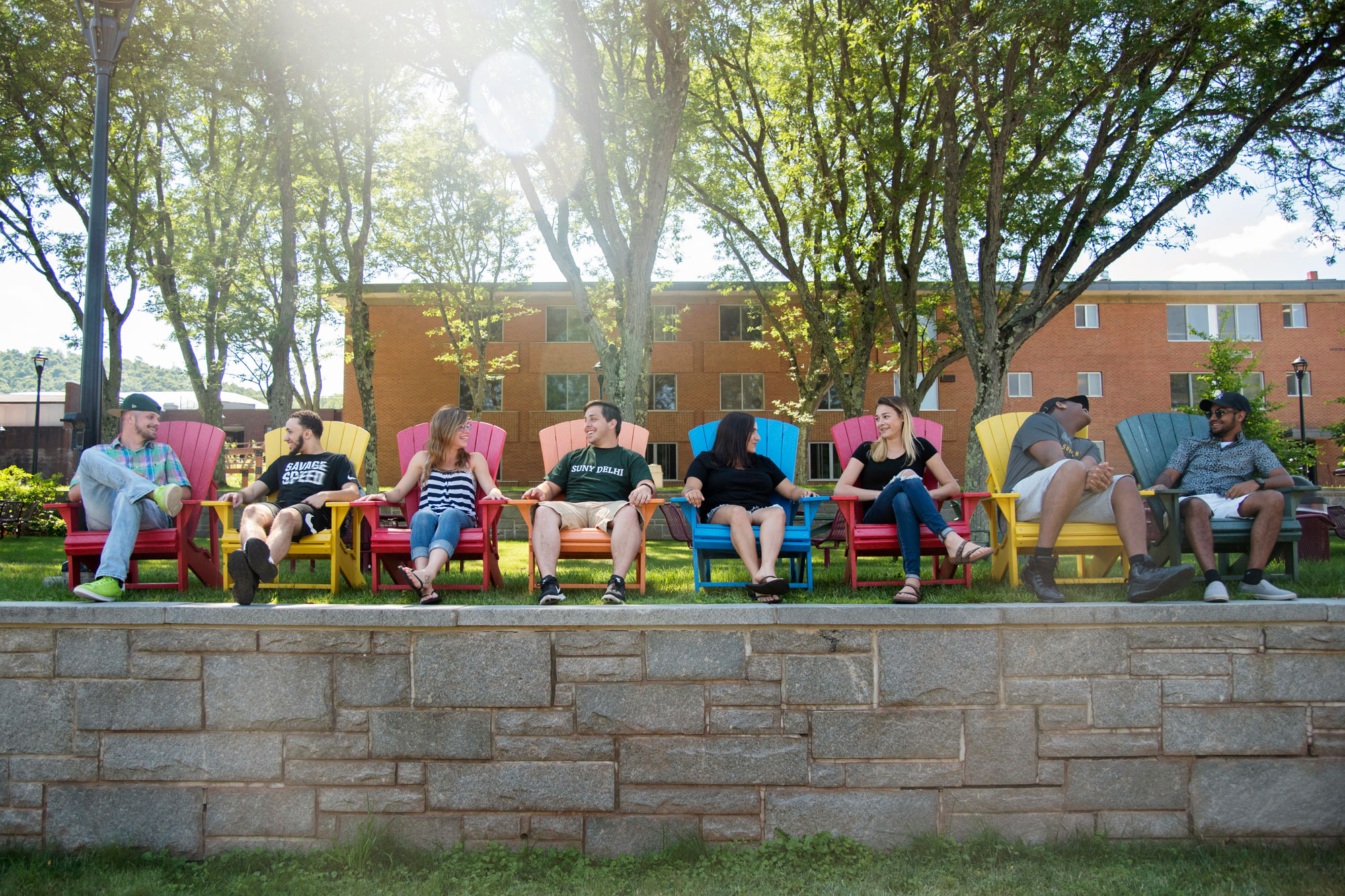 Kids Sitting on Colorful Seats